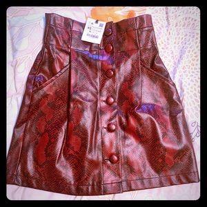 Red snakeskin print pleather mini skirt